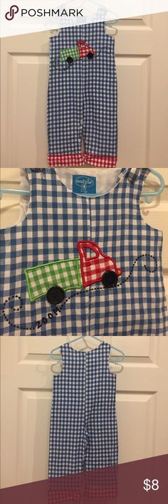 Mudpie overalls size 12-18m Excellent condition mud pie baby blue checked overalls with truck design. Very lightweight cotton, perfect for spring/summer or a warmer fall. Size 12–18 months. Mud Pie One Pieces