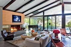 John Legend and Chrissy Teigen are living the Los Angeles dream in this cozy and delightfully bright home