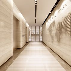 Lift lobby with textured wall and linear lighting trough detail