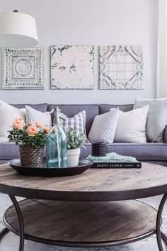 PURE SALT INTERIORS // ARIA PROJECT // LIVING // grey couch, succulents, potted plant, arched lamp, decorative pillows...