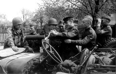 Meeting at the Elbe. Soviet and American soldiers greet each other and inspect one another's equipment, including an M1917 Browning machine gun mounted on a Jeep, after joining up near Torgau. The initial contact on 25 April 1945 between the Soviets, advancing from the East, and the Western Allies, advancing from the West, meant that the Allies had effectively cut Germany in two. The occasion would thereafter be commemorated as Elbe Day. Near Torgau, Saxony, Germany. 29 April 1945.