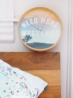 """""""NEED MORE WEEKENDS"""" Wall Clock by Wesley Bird on Society6."""