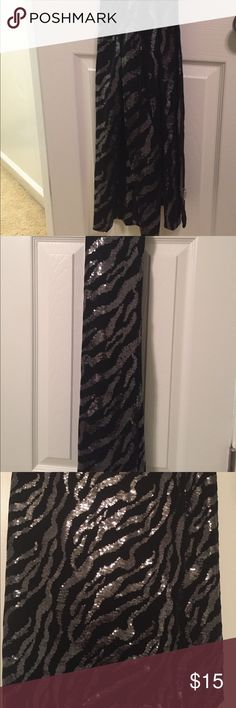 Black & silver scarf Gorgeous black & silver (sequined) accessory. Can be worn as a scarf for a more causal look or a wrap for a formal look. mary norton Accessories Scarves & Wraps
