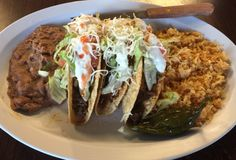 Steak and Bbqpork tacos from Tacos Elranchenito.  out of 5