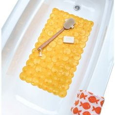 Add a splash of style to your tub with our #Twist of #Citrus Bath Mat! This fresh design features fun fruit slice patterns and deliciously bold colors. Made of du...