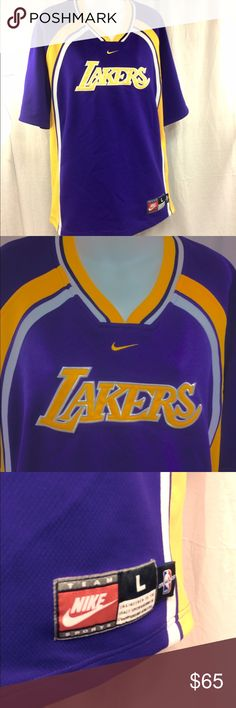 """Nike Men's Los Angeles Lakers Team Jersey Shirt L This jersey has been gently preloved, and is still in good condition! 😊 there is no name or number on it. So, it's a team shirt that always stays in style 😉 it's a men's large. From the back of the collar to the bottom hem measures about 31"""", shoulders measure about 24"""", the chest measures about 26"""" across from armpit to armpit. For some reason when I tried taking pics, it kept turning out Navy, but it's definitely dark purple & gold. 😜…"""