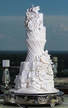 Elegant wedding cake like a female body form/wedding dress