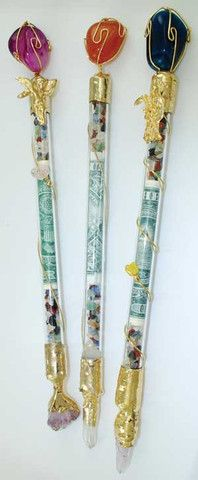 """This wonderfully crafted 8"""" wand has gemstones on either end and a golden line twisting about the wand from one end to the other.  Filled with gemstone chips and iconic representations of wealth to channel your energy properly, this device will aid you in all of your ritual needs. Styles and sizes will vary depending upon availability. $23.95"""