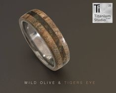 Titanium base ring with wild olive wood and tigers eye gemstone inlay. Wild Olive, Tigers Eye Gemstone, Titanium Rings, Wedding Bands, Rings For Men, Base, Engagement Rings, Gemstones, Wood