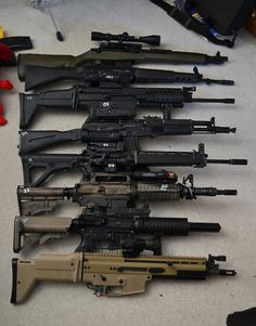 Family portrait! Springfield SOCOM 16, Howa Type 89, FN Mk.17 SCAR-H STD, Izhmash AK-105, 205th Armament T91, Colt M727, Griffin Armament M4-SD II, and FN Mk.16 SCAR-L CQC. #airsoftguns