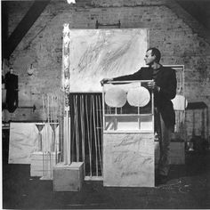 """""""Cy Twombly with Artworks at Fulton Street 1954"""", photo taken by Robert Rauschenberg in the studio they shared"""