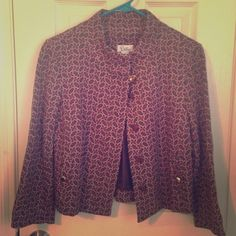 Lilly Pulitzer brown floral cropped jacket EUC Blazer-style cropped jacket with two faux pockets and concealed button front (top button visible with toggle closure, remaining four buttons hidden under lapel), beautiful gold buttons on sleeves, pockets, and front, and a lovely pattern featuring pink and white flowers on a satiny, viscose-blend fabric. Perfect for any season, any occasion, any place! EXCELLENT condition, never worn, only the buttons show slight slight wear from hanging in my…