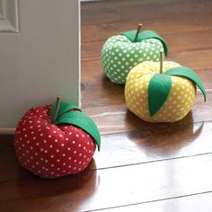 "Charis - These soft doorstoppers are adorable to prop open the nursery door or use it as a bookend.  Each cotton doorstopper is  in an apple shape with a different polka-dotted color.  Measures 6"" in diameter."