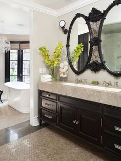This is a little (lot?) over the top for me, but I like the idea of the trough sink for the double vanities.