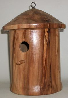 Birdhouse made on a wood lathe by Keith from a log of wood. www.keithgracely.com