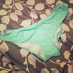 """Cute light blue PINK bathing suit bottoms """"Mermaid blue"""" bottoms cheeky butt with full ruching in the back a little bit in the front as well makes it cute and fun! Just doesn't work well with my body type PINK Victoria's Secret Swim Bikinis"""