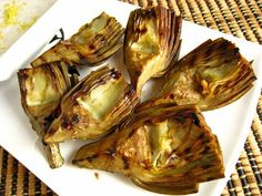 Roasted artichokes, YUM! Google Image Result for http://3.bp.blogspot.com/_UIXOn06Pz70/SI5BRsUotJI/AAAAAAAAD9M/NasjN-OzV2w/s800/Grilled+Artichokes+with+Lemon+Aioli+500.jpg