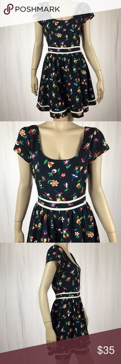 Cutest Luca Couture Vibrant Floral Baby Doll Dress Cutest Luca Couture Vibrant Floral Baby Doll Dress. I am in love with this dress!! So stinkin' adorable. Great condition. No size tags but fits like a medium. Approx. measurements: 28 inch waist, 33 inch bust, 33 inch length. Pleated Skirt. Super cute Button Up back on the top and zipper on the bottom. Shell is 95% polyester and 5% spandex and the lining is 100% polyester. Lucca Couture Dresses Mini