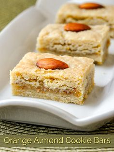 Orange Almond Cookie Bars. Ground almonds and orange zest form the centre of these delicious cookie bars. They freeze well for Holiday baking or to keep them on hand for a tea break at any time. #christmascookies #christmasbaking #freezerfriendlyrecipes #cookiebars #baking