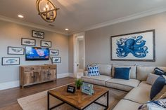 neutral nautical family room with blue accents