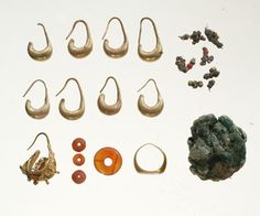 Ancient Canaanite Gold and Silver Jewelry - Stunning gold and silver jewelry, including a ring, earrings, and beads, has been unearthed by Israeli archaeologists as part of an ancient treasure trove at Tel Megiddo.