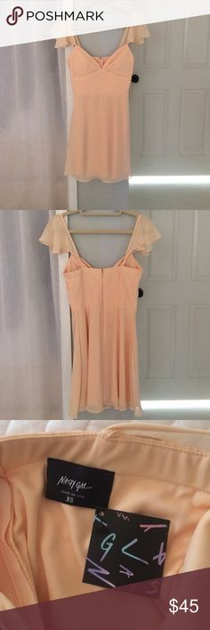 Nasty Gal All A Flutter Dress (new with tags) Pretty blush colored dress from nasty gal! So pretty but unfortunately slightly too big on me! Never worn Nasty Gal Dresses Mini
