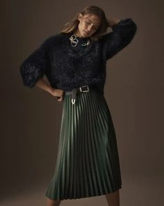 3e753eade7ff What a chic combo. A woman wearing a black top paired with a long dark  green pleated skirt. Image by Marks & Spencer.