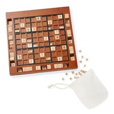 A beautifully-crafted, wooden Sudoku game board with special slots to store the wood number tiles. Share a cup of coffee and enjoy a game of Sudoku for a perfect pairing.