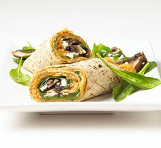 This wrap recipe combines a bean puree, spinach mixture, sliced portobello mushrooms, and cheese into a delectable main dish.