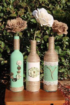 Decorative Bottles : Did you want to paint some? I'm thinking about taking back the Hob Lob invitations. They won't go well with the doilies. Wine Bottle Design, Wine Bottle Art, Diy Bottle, Wine Bottle Crafts, Mason Jar Crafts, Mason Jars, Twine Wine Bottles, Bottles And Jars, Glass Bottles