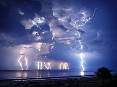 'Summer Storm' - photo by Ed Hetherington;  A late summer storm over the Atlantic Ocean in Hilton Head, South Carolina.  The different color temperature of the bolts were how they actually looked. It seemed as though the bolts that were in rainy areas had a warmer color to them.