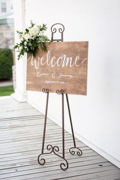 Elegant wedding sign idea - wooden wedding welcome sign with greenery + white flowers {Amber Green Photography}