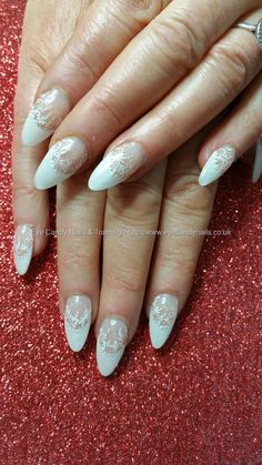 White french acrylic almond nails with freehand lace nail art