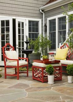 20 Beautiful Patios (on a Budget) - bold spray painted basic furniture with cushions