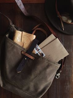 valscrapbook:  tothecatcher tothecatcher: Shipping orders today, a task made easier by my heavy duty and just as handsome pegandawl waxed canvas tote. (Shameless plug because I'm in love with the craftsmanship and character that they build back into recovered materials.)