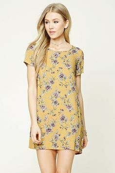 Floral print shift dress - A woven dress featuring an allover floral print, a shift silhouette, round neckline, short sleeves, an exposed back zipper, and a short length.
