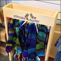 Here is a natural display look exemplified by this Solmate Socks Freestanding Wood Rack as display promotion in Sporting Goods retail.