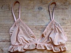 I adore!!! this bra. It reminds me of a pink satin (flat with ruffles) 'play' bra I wore as a little girl of 7.