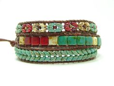This southwestern style wrap bracelet is made of 2.5 x 5mm green picasso superduo beads woven in a herringbone pattern, mixed picasso 6mm tile beads and ending with a mix of red, cream & green picasso superduo beads using distressed brown leather cord with a southwestern style silver metal button for the closure. The bracelet has 2 loops and measures at 20 1/2, 21 1/2.  If you need a different size, let me know at checkout. It will add 2-3 days to order.