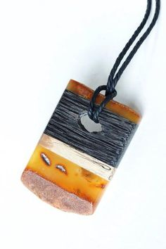 Marta Wlodarska combines natural Baltic amber with various forms of wood, silver, linen, and leather.