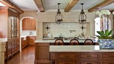 Warm Kitchen. Love those beams! Studio William Hefner. -via Interior Canvas