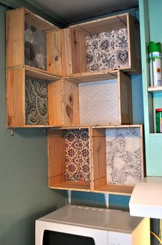 Wine crate shelves... I would put these in the laundry rm