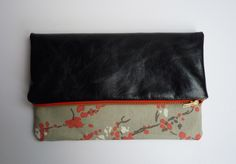 Multi style leather and abstract blossom print fabric clutch bag, small £39.00.  Lots of others too.