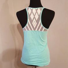 Lace Racer back tank top Tiffany blue colored scoop neck racer back tank. Very lightweight. Size medium. Worn once. Free of rips, stains and odors. No trades. American Eagle Outfitters Tops Tank Tops