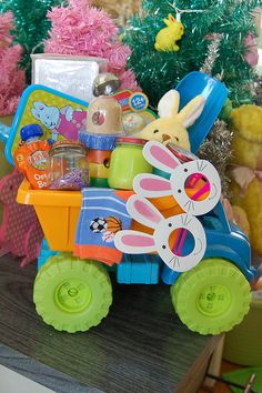 Easter Basket for baby... I love that its in a dump truck! That would be a fun thing to start is making a toy be the basket. Maybe next year for parker