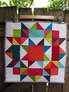 rainbow mini Swoon quilt. I have to figure out how to quilt that way.