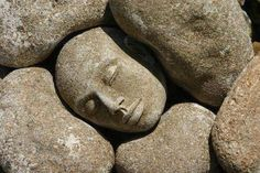 It is a very simple sculpture. A face was sculpted and textured with rock like color with a rough look to it. It was placed within rocks to give it naturalism.