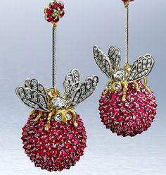 ARK earrings | Bug-eyed diamond bees perch atop luscious balls of rubies.
