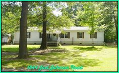 Unbelievable price for this highly unique opportunity! Manufactured home w/ 0.97 acres, adorable cabin, HUGE workshop, 2 car storage shelter, garden house, & tool shed! Fenced yard shaded by hardwood trees, spacious backyard patio, & brick BBQ station. Home formerly 3 bdrm, has been converted to 2 bdrm w/ large WI laundry rm. WORKSHOP measures 30'x50', roll up door, & 8' high ceiling. Unfinished bonus rm above workshop could make great game rm. SOLD AS IS