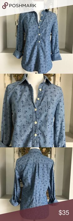 J. Crew Anchor Chambray Popover J. Crew Anchor Chambray Popover 1/4 Button Down Shirt. Size small. More of a loose fit in my opinion than fitted.. 100% cotton. Great condition. J. Crew Factory Tops Button Down Shirts